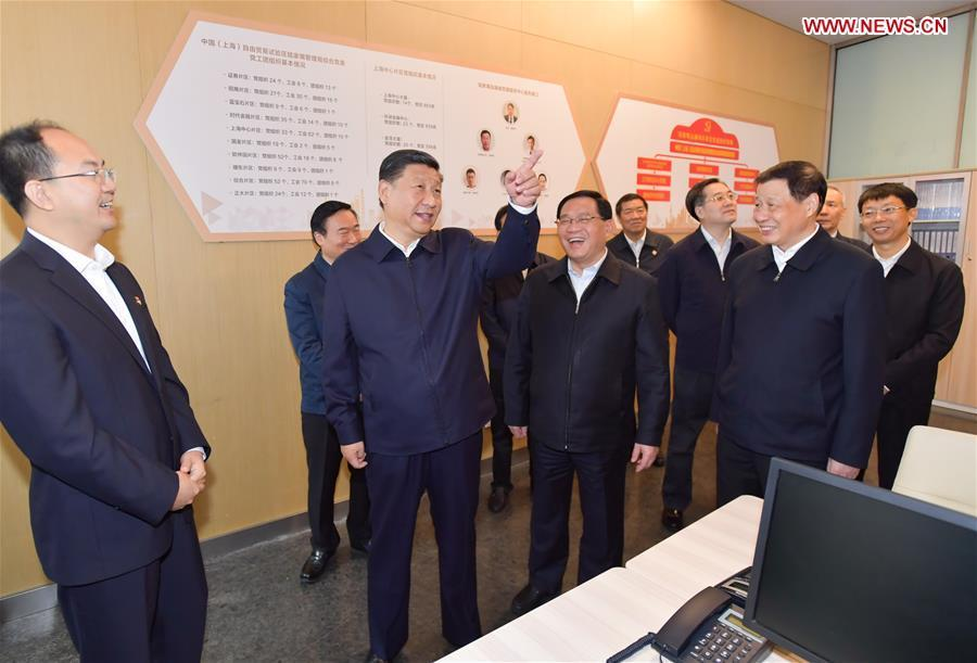 Xi Jinping (2nd L), general secretary of the Communist Party of China (CPC) Central Committee, Chinese president and chairman of the Central Military Commission, inspects the Lujiazui Financial City CPC construction service center in the Shanghai Tower to learn the CPC construction work of the skyscrapers in Pudong New District of Shanghai, east China, Nov. 6, 2018. Xi Jinping inspected Shanghai on Tuesday. (Xinhua/Li Tao)