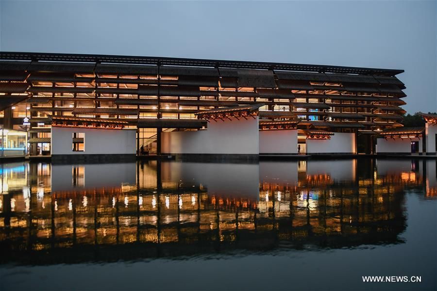 Photo taken on Nov. 6, 2018 shows the night scenery of Wuzhen International Internet Exhibition and Convention Center, a permanent home for the World Internet Conference, in Wuzhen, east China\'s Zhejiang Province. The fifth World Internet Conference (WIC) is scheduled to run from November 7-9 in the river town of Wuzhen. (Xinhua/Huang Zongzhi)