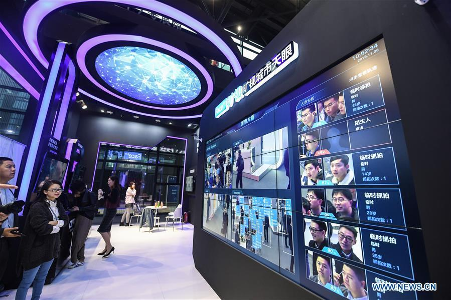A facial recognition system is displayed at the Light of Internet Expo of the fifth World Internet Conference in Wuzhen Township of Tongxiang, east China\'s Zhejiang Province, Nov. 6, 2018. Opening here on Tuesday, the exposition focuses on the world\'s most recent internet development trends and cutting-edge technologies, showing the latest internet technologies, achievements, products and applications of more than 430 enterprises and institutions from home and abroad. (Xinhua/Xu Yu)