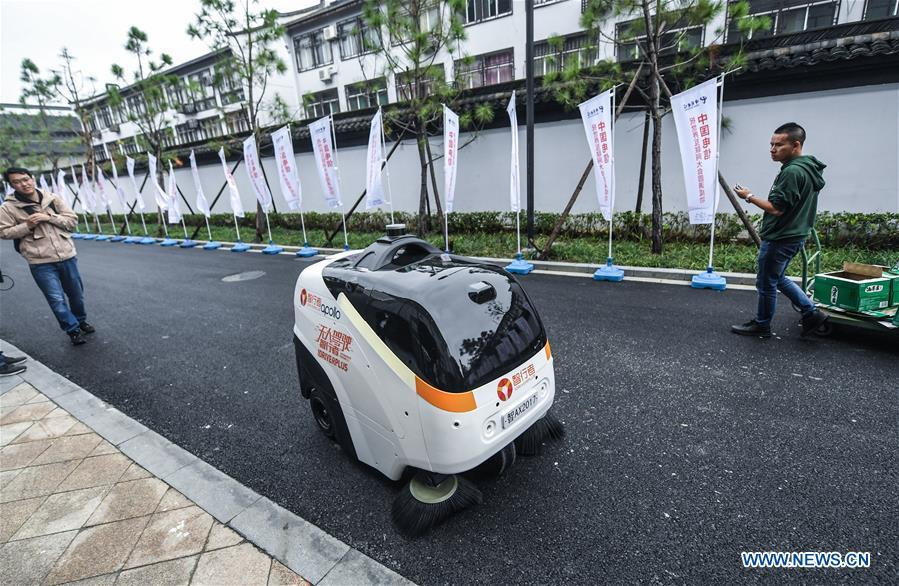 An automatic cleaning robot is at work during the Light of Internet Expo of the fifth World Internet Conference in Wuzhen Township of Tongxiang, east China\'s Zhejiang Province, Nov. 6, 2018. Opening here on Tuesday, the exposition focuses on the world\'s most recent internet development trends and cutting-edge technologies, showing the latest internet technologies, achievements, products and applications of more than 430 enterprises and institutions from home and abroad. (Xinhua/Xu Yu)
