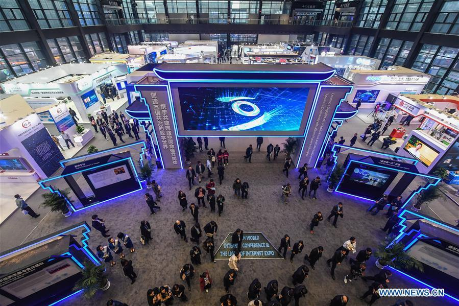 People visit the Light of Internet Expo of the fifth World Internet Conference in Wuzhen Township of Tongxiang, east China\'s Zhejiang Province, Nov. 6, 2018. Opening here on Tuesday, the exposition focuses on the world\'s most recent internet development trends and cutting-edge technologies, showing the latest internet technologies, achievements, products and applications of more than 430 enterprises and institutions from home and abroad. (Xinhua/Xu Yu)