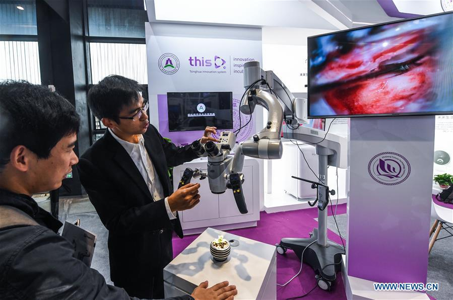An exhibitor shows a 3D high-definition surgical microscopic video camera system at the Light of Internet Expo of the fifth World Internet Conference in Wuzhen Township of Tongxiang, east China\'s Zhejiang Province, Nov. 6, 2018. Opening here on Tuesday, the exposition focuses on the world\'s most recent internet development trends and cutting-edge technologies, showing the latest internet technologies, achievements, products and applications of more than 430 enterprises and institutions from home and abroad. (Xinhua/Xu Yu)