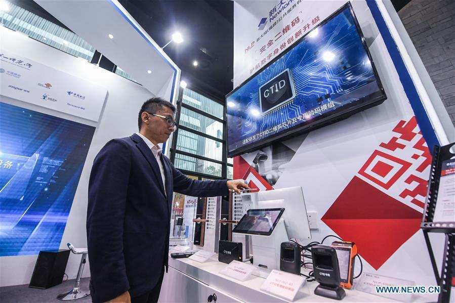 An exhibitor shows an internet-based digital identification system, known as CTID, at the Light of Internet Expo of the fifth World Internet Conference in Wuzhen Township of Tongxiang, east China\'s Zhejiang Province, Nov. 6, 2018. Opening here on Tuesday, the exposition focuses on the world\'s most recent internet development trends and cutting-edge technologies, showing the latest internet technologies, achievements, products and applications of more than 430 enterprises and institutions from home and abroad. (Xinhua/Xu Yu)