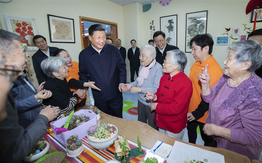 Chinese President Xi Jinping, also general secretary of the Communist Party of China Central Committee and chairman of the Central Military Commission, talks with elderly citizens at a nursery for the elderly of a community center in Hongkou District of east China\'s Shanghai, Nov. 6, 2018. Xi Jinping made a two-day inspection in Shanghai, which ended on Wednesday. (Xinhua/Li Tao)