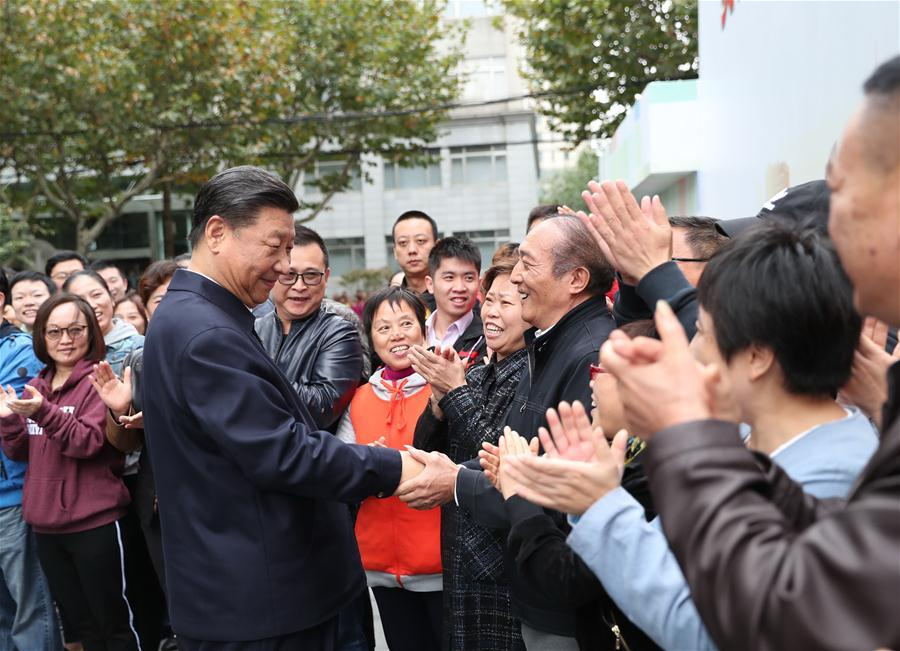 Chinese President Xi Jinping, also general secretary of the Communist Party of China Central Committee and chairman of the Central Military Commission, shakes hands with local residents at a community center in Hongkou District of east China\'s Shanghai, Nov. 6, 2018. Xi Jinping made a two-day inspection in Shanghai, which ended on Wednesday. (Xinhua/Xie Huanchi)