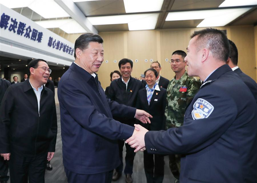 Chinese President Xi Jinping, also general secretary of the Communist Party of China Central Committee and chairman of the Central Military Commission, shakes hands with staff members at the urban management center in Pudong New Area of east China\'s Shanghai, Nov. 6, 2018. Xi Jinping made a two-day inspection in Shanghai, which ended on Wednesday. (Xinhua/Xie Huanchi)