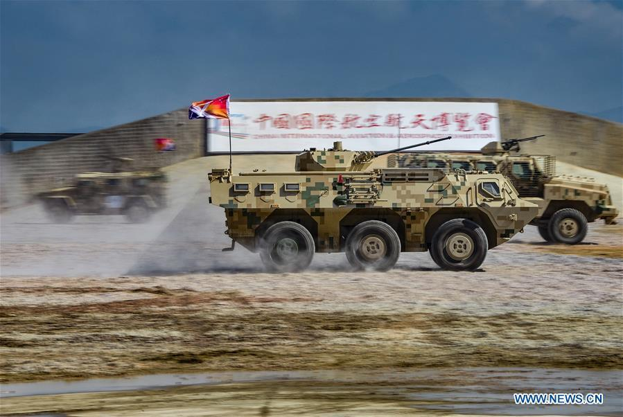 Armored vehicles attend a dynamic display of ground military equipments at the 12th China International Aviation and Aerospace Exhibition (Airshow China) in Zhuhai, south China\'s Guangdong Province, on Nov. 7, 2018. (Xinhua/Yang Guang)