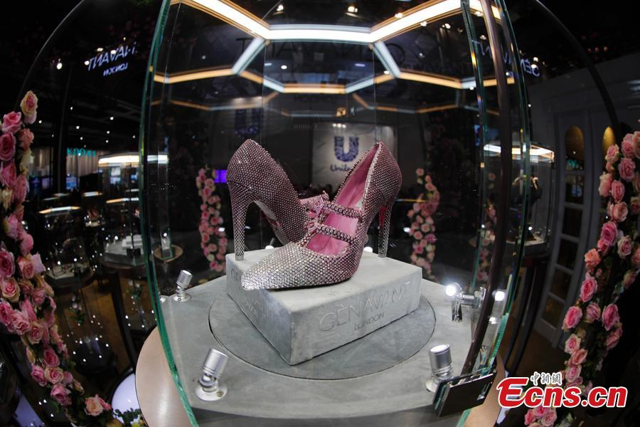 A pair of diamond shoes worth $4.35 million made their debut at China International Import Expo (CIIE) in Shanghai. They are designed and made by couture shoe designer Jimmy Choo. (Photo: China News Service/Du Yang)