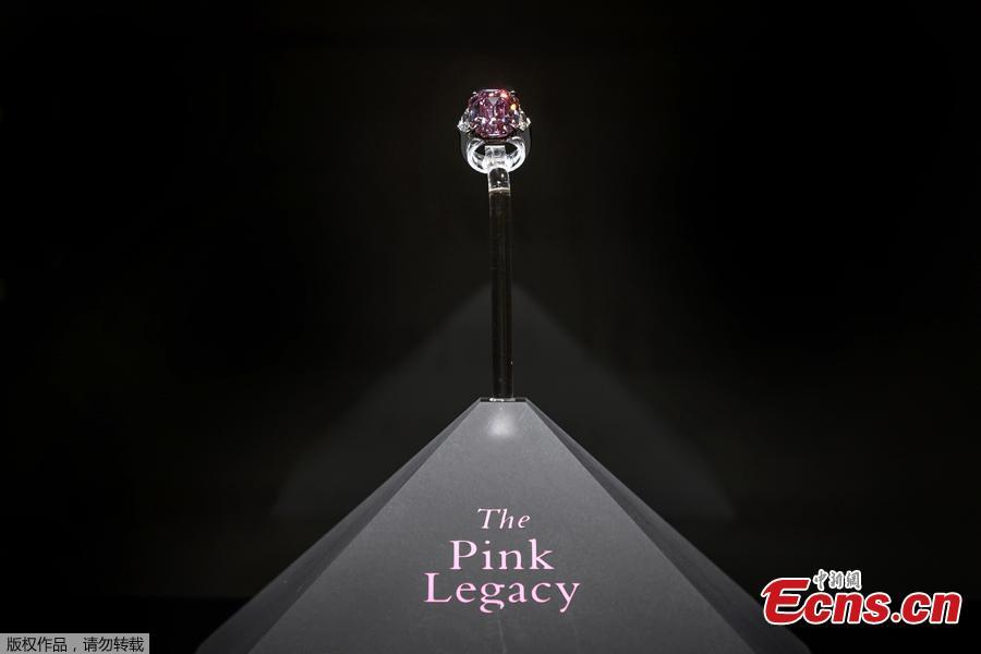 The Pink Legacy, a 18.96 carat fancy vivid pink diamond once owned by Oppenheimer family is displayed on November 8, 2018 during a press preview ahead of sales by Christie\'s auction house in Geneva. - The auction will take place in Geneva on November 13, 2018.  (Photo/Agencies)