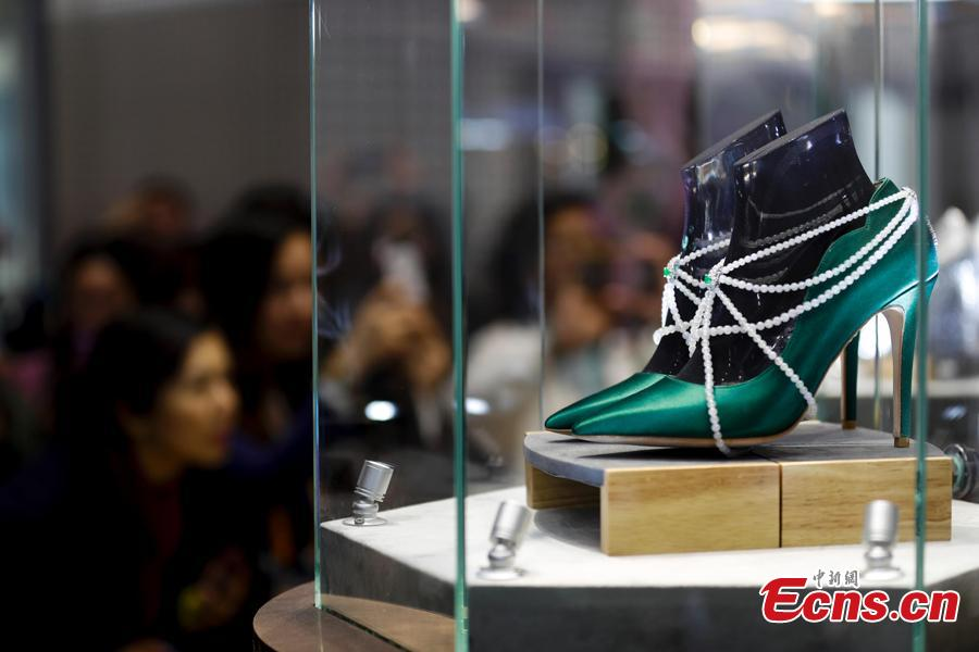 A pair of shoes with jewelries are exhibited at China International Import Expo (CIIE) in Shanghai. (Photo: China News Service/Du Yang)