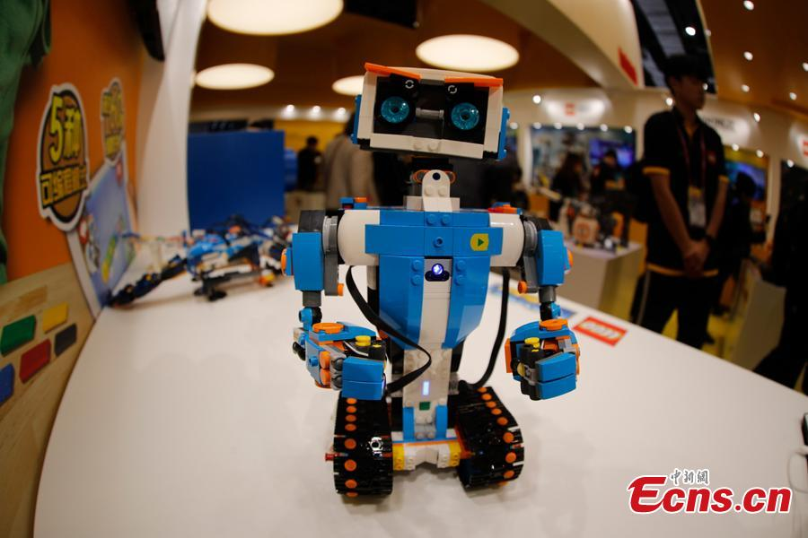 An intelligent toy robot developed by LEGO Group is displayed at the first China International Import Expo in Shanghai, Nov. 8, 2018. (Photo: China News Service/ Du Yang)