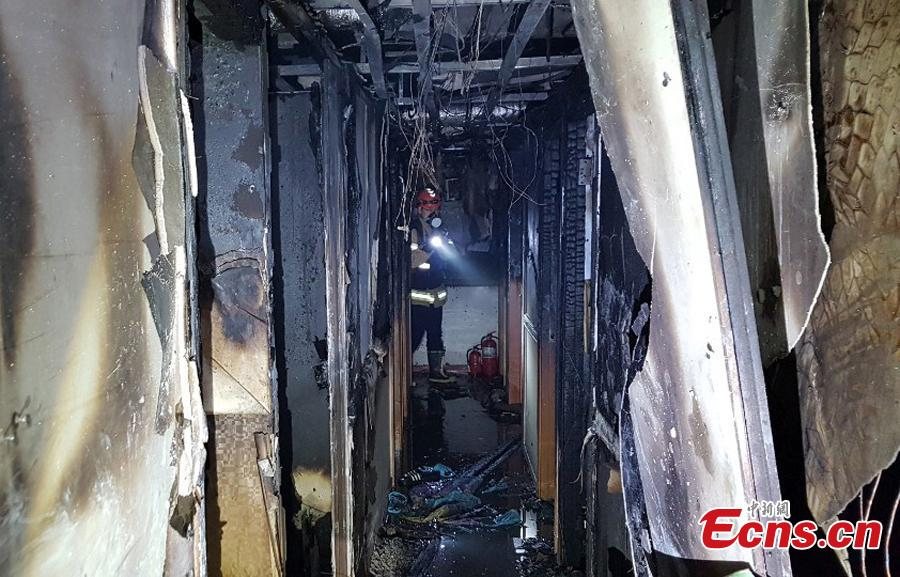 A fire at a low-cost dormitory-style housing facility in central Seoul, South Korea, is put out on Nov. 9, 2018. The fire killed at least seven people and injured 11.  Authorities are investigating possible safety lapses in the building. (Photo providedto China News Service)