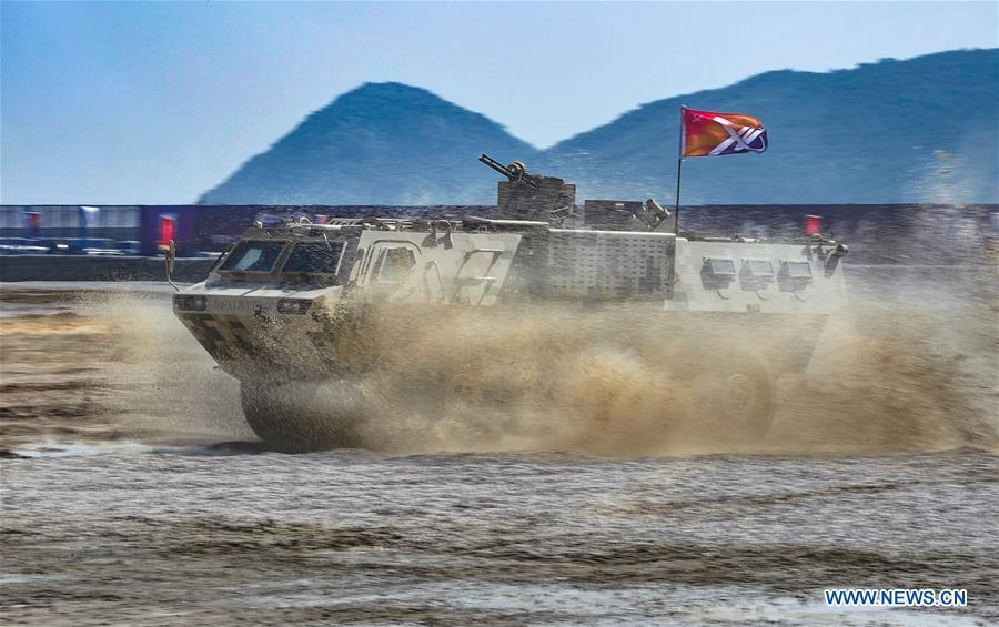 An armored vehicle attends a dynamic display of ground military equipments at the 12th China International Aviation and Aerospace Exhibition (Airshow China) in Zhuhai, south China\'s Guangdong Province, on Nov. 7, 2018. (Xinhua/Yang Guang)