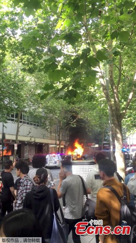 A burning car is seen near the Bourke Street mall, in Melbourne, Australia, November 9, 2018 in this picture grab obtained from social media video. Australian police reported multiple people were hurt after a man set a car on fire and allegedly stabbed a number of people in Melbourne\'s Bourke St. (Photo/Agencies)