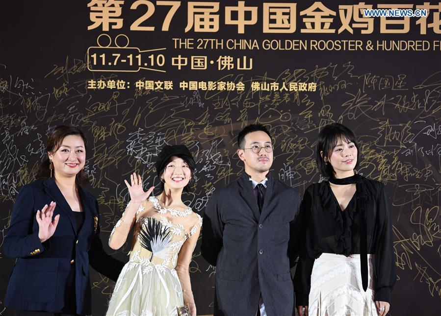 Actresses Zhou Dongyu (2nd L) and Ma Sichun (1st R) attend the red carpet ceremony of the 27th China Golden Rooster & Hundred Flowers Film Festival in Foshan, south China\'s Guangdong Province, Nov. 10, 2018. The red carpet ceremony of the 27th China Golden Rooster & Hundred Flowers Film Festival was held here on Saturday. (Xinhua/Deng Hua)