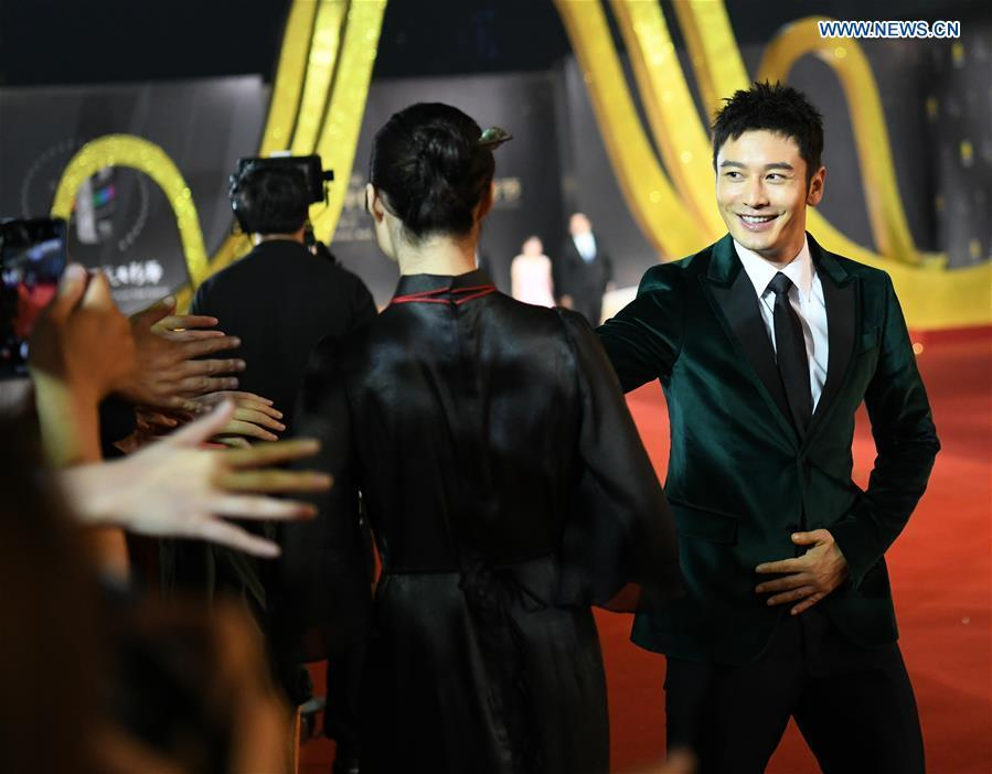 Actor Huang Xiaoming attends the red carpet ceremony of the 27th China Golden Rooster & Hundred Flowers Film Festival in Foshan, south China\'s Guangdong Province, Nov. 10, 2018. The red carpet ceremony of the 27th China Golden Rooster & Hundred Flowers Film Festival was held here on Saturday. (Xinhua/Deng Hua)