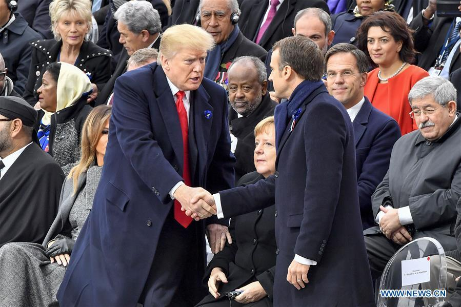 French President Emmanuel Macron (R, Front) shakes hands with U.S. President Donald Trump during a ceremony to mark the centenary of the Armistice of the First World War in Paris, France, Nov. 11, 2018. (Xinhua/Chen Yichen)