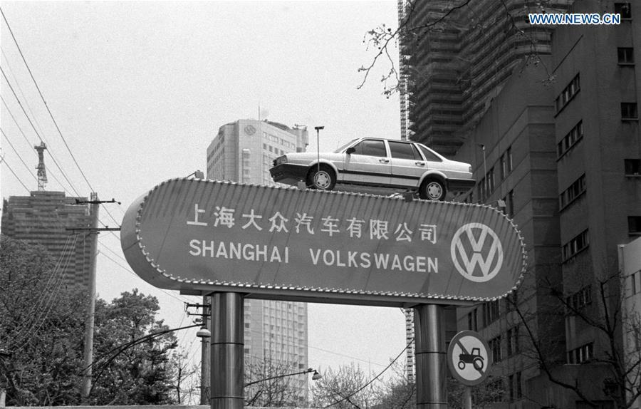 A Santana car made by Volkswagen is placed on a sign of Shanghai Volkswagen, a China-Germany joint venture, in this file photo taken in May 1990 in Shanghai, east China. (Xinhua/Xia Daoling)
