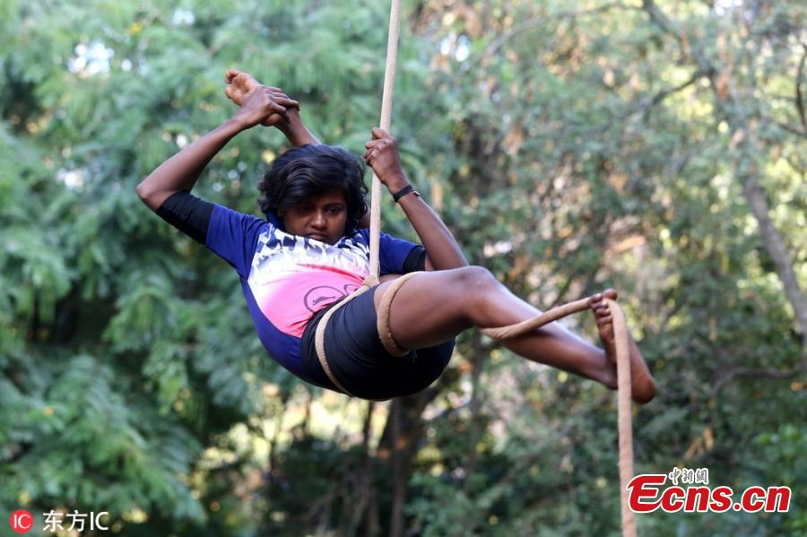 An Indian School child performs rope yoga ahead of children\'s day festival at a park, in Bangalore, India, 10 November 2018. Children\'s day, in India is celebrated every year on 14 November to increase the awareness of people towards the rights, care, and education of children. (Photo/IC)