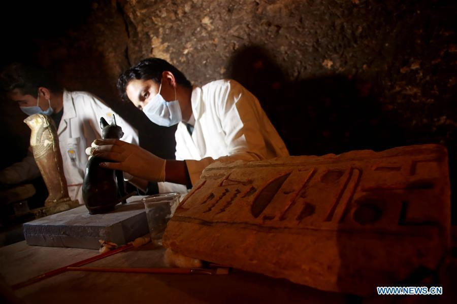 Archeologists work in a tomb in Saqqara Necropolis, Giza Province, Egypt, on Nov. 10, 2018. Egypt\'s Minister of Antiquities Khaled al-Anany announced Saturday the discovery of seven pharaonic tombs in Saqqara Necropolis. (Xinhua/Ahmed Gomaa)