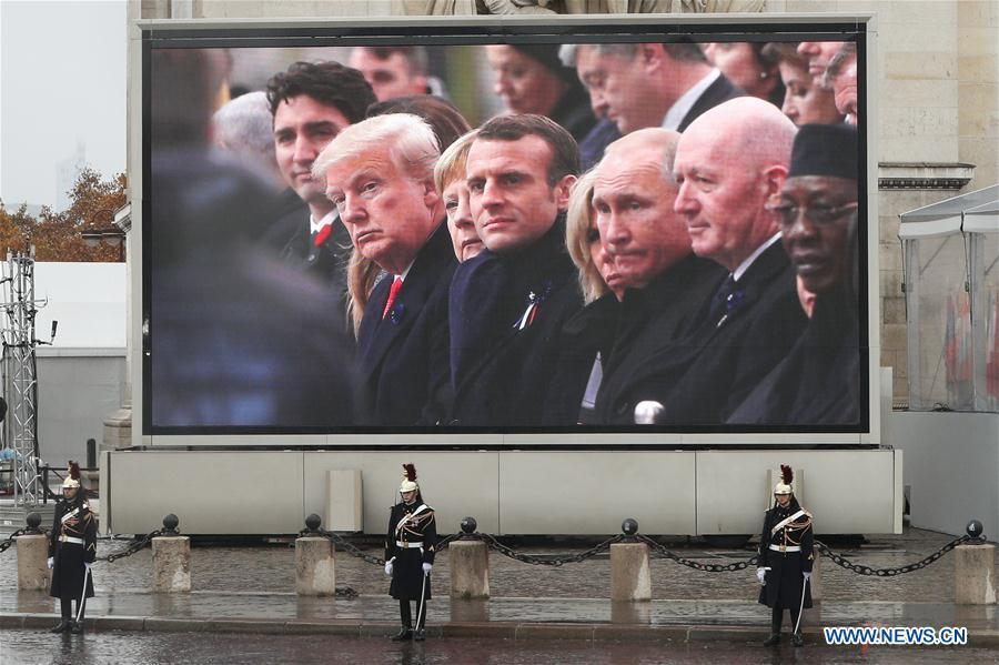 A screen in front of the Arc de Triomphe shows the US President Donald Trump, German Chancellor Angela Merkel, French President Emmanuel Macron, Russian President Vladimir Putin and other politicians attend the ceremony to commemorate the 100th anniversary of the end of World War I in Paris, France, Nov. 11, 2018. (Xinhua/Zheng Huansong)