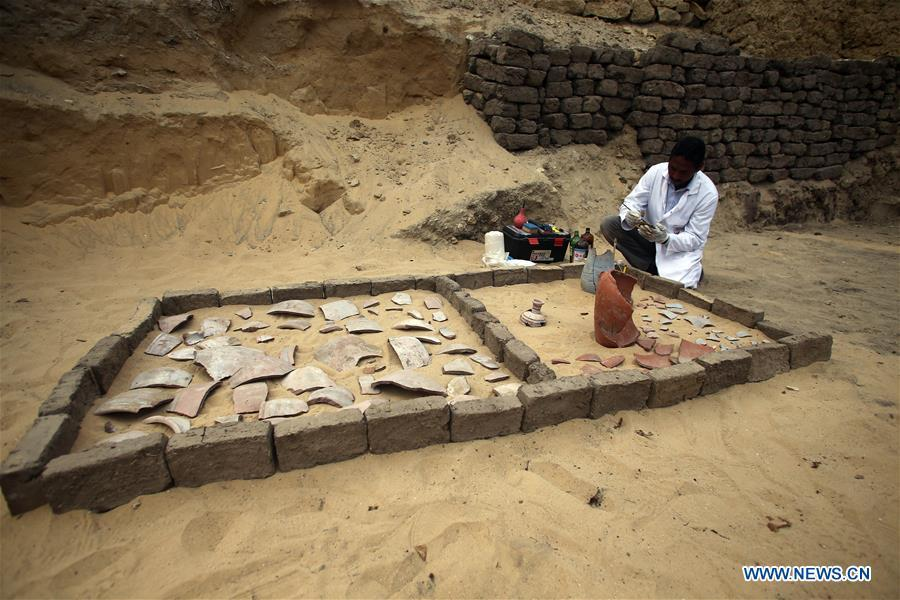 An archeologist works in Saqqara Necropolis, Giza Province, Egypt, on Nov. 10, 2018. Egypt\'s Minister of Antiquities Khaled al-Anany announced Saturday the discovery of seven pharaonic tombs in Saqqara Necropolis. (Xinhua/Ahmed Gomaa)
