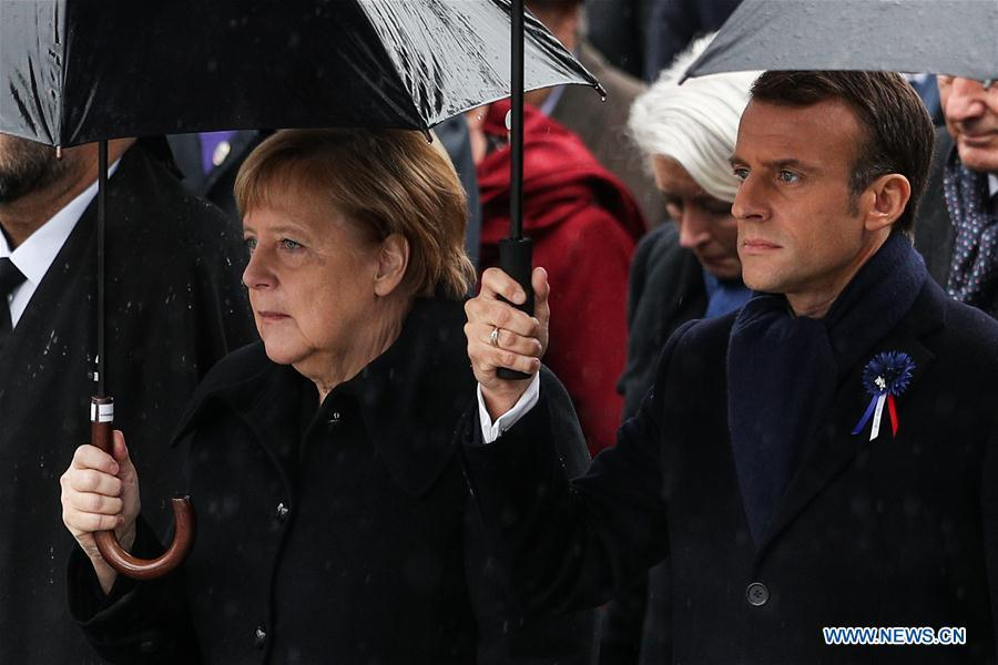 French President Emmanuel Macron and German Chancellor Angela Merkel walk to the ceremony to commemorate the 100th anniversary of the end of World War I in Paris, France, Nov. 11, 2018. (Xinhua/Zheng Huansong)