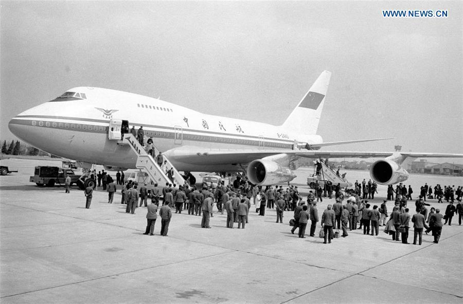 Undated photo shows passengers disembarking from a Boeing airliner. The Civil Aviation Administration of China (CAAC) in 1980 put into use a Boeing 747SP airliner, the first of such a move. (Xinhua/Song Lianfeng)