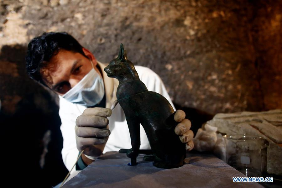 An archeologist works in a tomb in Saqqara Necropolis, Giza Province, Egypt, on Nov. 10, 2018. Egypt\'s Minister of Antiquities Khaled al-Anany announced Saturday the discovery of seven pharaonic tombs in Saqqara Necropolis. (Xinhua/Ahmed Gomaa)