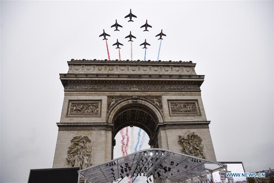 The Patrouille de France aerobatic team performs during a ceremony to mark the centenary of the Armistice of the First World War in Paris, France, Nov. 11, 2018. (Xinhua/Chen Yichen)