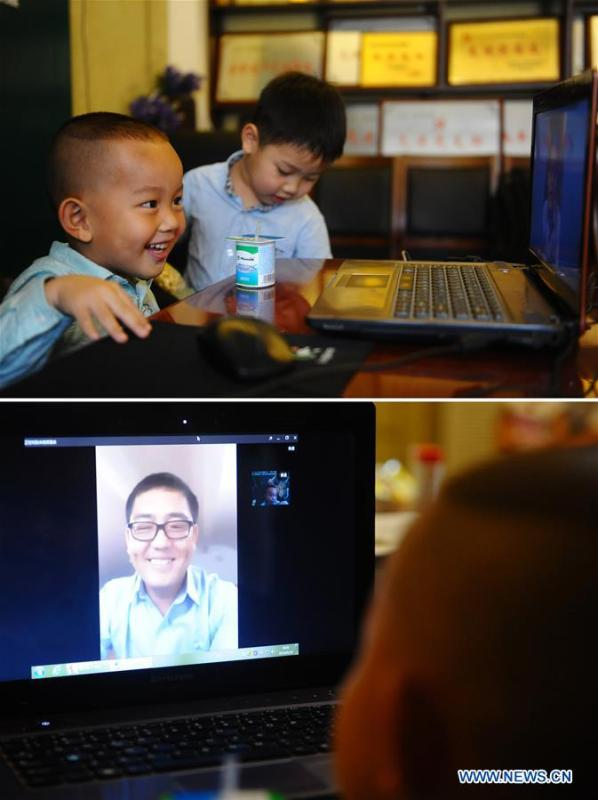 Combined photo shows Wang Yin (L upper) talking with his father Wang Yutao (lower) who is in Ecuador for electrical work via video chat system in Changchun, northeast China\'s Jilin Province, June 18, 2016. More than four decades of sound economic growth from 1978, the starting year of the reform and opening-up policy, has fundamentally lifted life quality of 1.3 billion Chinese, who are now able to enjoy the \