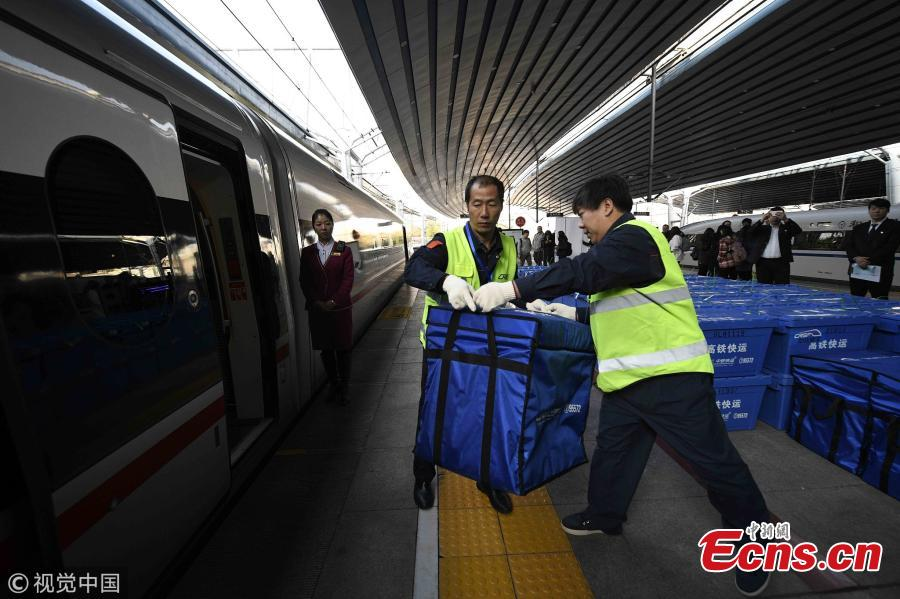 Fuxing bullet trains between Beijing and Changsha, the capital city of Central China\'s Hunan province, join the battle to deliver for Singles\' Day, an annual e-commerce shopping spree in China that falls on last Sunday. It is the first time that two Fuxing bullet trains between Beijing and Changsha deliver goods bought on Singles\' Day from Nov 11 to 20, each with a delivery capacity of about 50,000 tonnes. One carriage of each train will carry goods, mainly documents, garments, food, electronic devices, and others. Delivery time will be cut down to about five hours, faster than road transportation which usually takes 20 to 24 hours. (Photo/VCG)