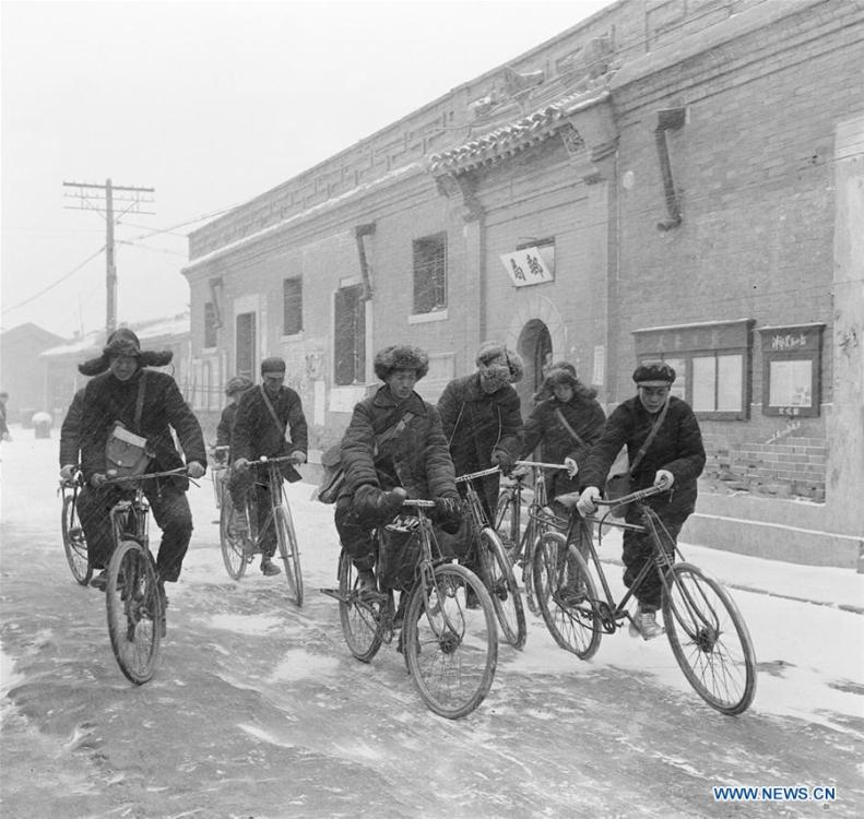 Postmen ride bikes to send newspapers to subscribers in the suburbs of Tianjin, north China, in March, 1956. More than four decades of sound economic growth from 1978, the starting year of the reform and opening-up policy, has fundamentally lifted life quality of 1.3 billion Chinese, who are now able to enjoy the \