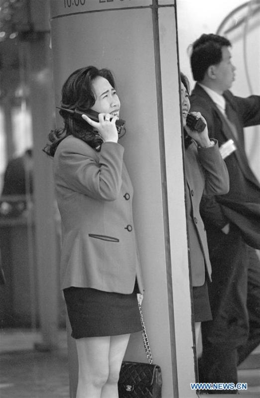 Photo taken in January of 1995 shows a woman using a brick-size cellular phone in Shanghai, east China. Shanghai had about 70,000 users of mobile phone in 1995. More than four decades of sound economic growth from 1978, the starting year of the reform and opening-up policy, has fundamentally lifted life quality of 1.3 billion Chinese, who are now able to enjoy the \