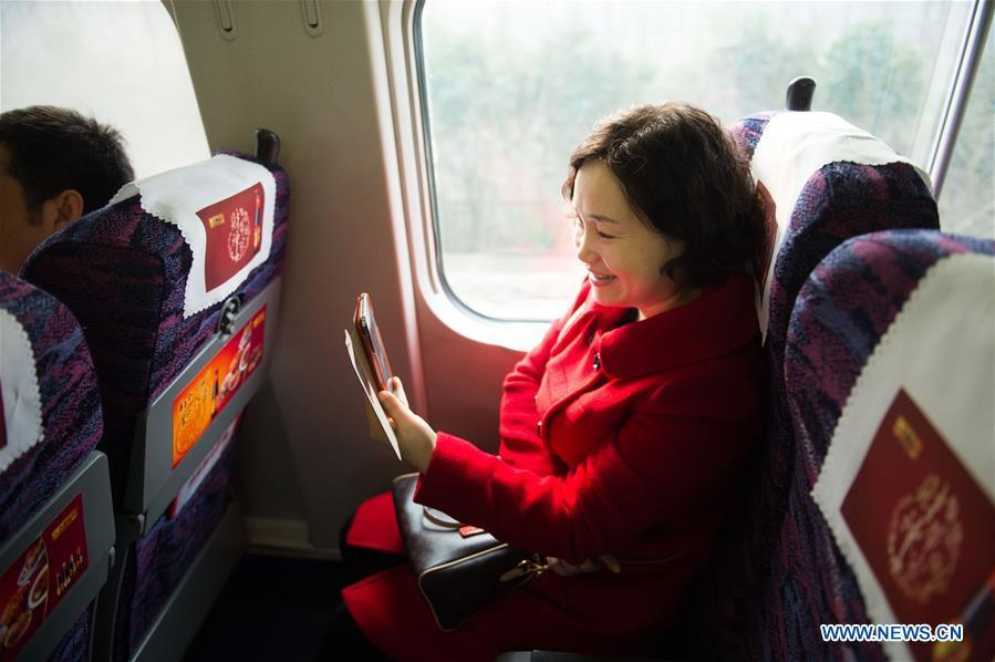 A passenger talks with her friend through a phone video call using 4G network on a bullet train from Hefei, east China\'s Anhui Province, to Jiangshan, east China\'s Zhejiang Province, Feb. 4, 2015. High-speed railways in Anhui started to offer 4G service to passengers during the Spring Festival travel rush in 2015. More than four decades of sound economic growth from 1978, the starting year of the reform and opening-up policy, has fundamentally lifted life quality of 1.3 billion Chinese, who are now able to enjoy the \