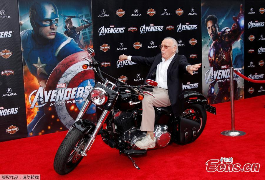 File photo: Comic book creator and executive producer Stan Lee poses on a motorcycle at the world premiere of the film \