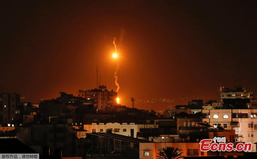 A picture taken on November 12, 2018 shows flares dropped by Israeli warplanes above Gaza city.  Israel\'s military said it was carrying out air strikes \