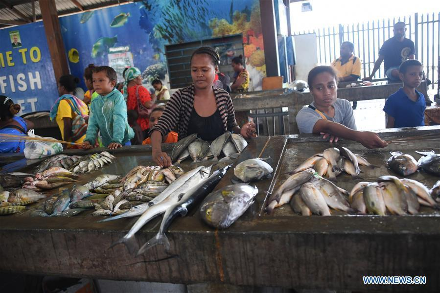 Photo taken on Nov. 11, 2018 shows a fish market in Port Moresby, Papua New Guinea. Leaders from the Asia-Pacific economies are gathering in Port Moresby, the capital of Papua New Guinea for the Asia-Pacific Economic Cooperation (APEC) Leaders\' Week on Nov. 12-18. (Xinhua/Lui Siu Wai)