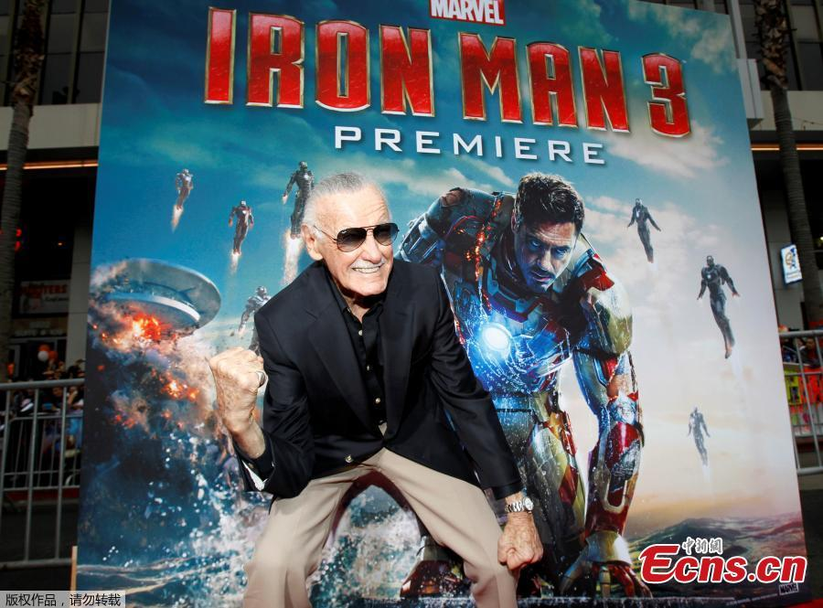 File photo: Stan Lee gestures as he poses at the premiere of \