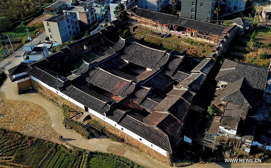 Aerial photo taken on Nov. 11, 2018 shows the scenery of Aijing Zhuang residential complex in Yangwei Village of Yongtai County, southeast China\'s Fujian Province. The project, with a total of 361 rooms covering the area of over 5,200 square meters, was built during the reign of Emperor Daoguang in the Qing Dynasty. It has safeguarded the authentic character of the vernacular housing, defensive structures and waterways that are emblematic of this site, providing a model for other historic villages across China. The conservation of Aijing Zhuang residential complex demonstrates a sensitive approach to sustaining a rural settlement as a living place in harmony with its natural setting. Aijing Zhuang in November this year received the Award of Merit in the 2018 UNESCO Asia-Pacific Awards for Cultural Heritage Conservation. (Xinhua/Zhang Guojun)