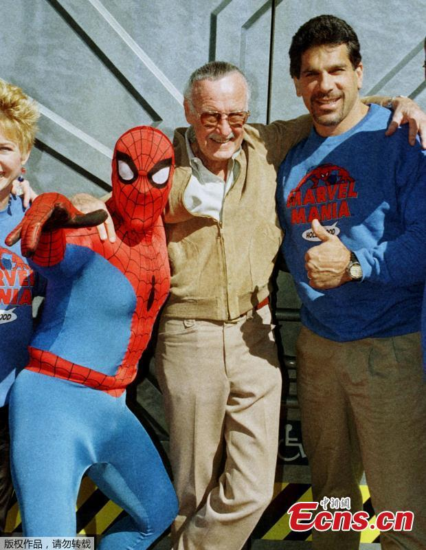 File photo: Marvel Comic Books founder Stan Lee (C) poses with one of his characters \