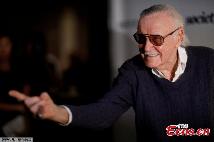 File photo: Marvel Comics co-creator Stan Lee poses at a tribute event \