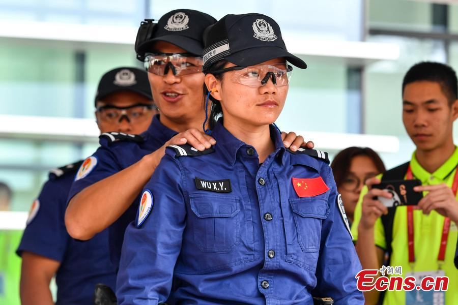 The second USIP World Police Service Pistol Shooting Championship takes place at the Guangdong provincial police training center in Foshan, Guangdong province on November 14, 2018. A total of 256 police from nearly 70 countries and regions across the world registered for the contest. (Photo: China News Service/ Chen Jimin)