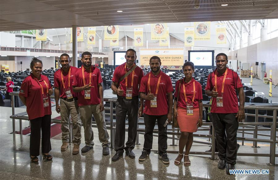 Staff pose for a group photo at the APEC 2018 International Media Centre in Port Moresby, Papua New Guinea (PNG), on Nov. 13, 2018. PNG, comprising about 600 small islands, is the host of the APEC meetings this year. The media center opened to journalists on Monday and will be in use until Nov. 18. (Xinhua/Bai Xuefei)