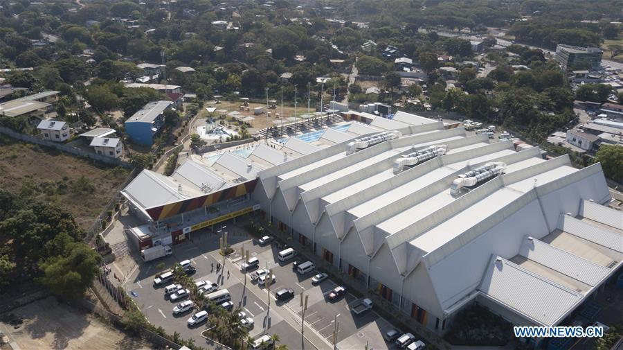 Aerial photo taken on Nov. 9, 2018 shows the APEC 2018 International Media Centre in Port Moresby, Papua New Guinea (PNG). PNG, comprising about 600 small islands, is the host of the APEC meetings this year. The media centre opened to journalists on Monday and will be in use until Nov. 18. (Xinhua/Lui Siu Wai)