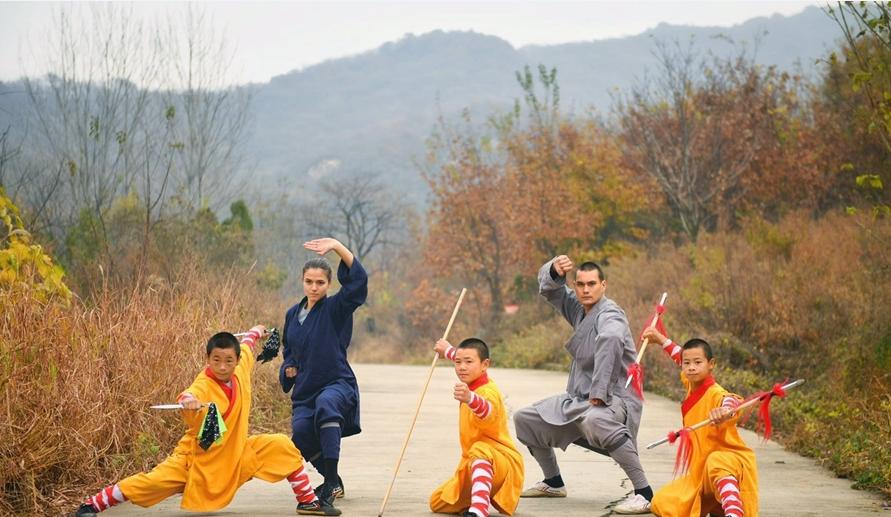 Monks at the famed Shaolin Temple exercise under the autumn leaves, November 11, 2018. The reputed birthplace of Kung Fu, the Shaolin Buddhist Temple lies at the foot of Songshan Mountain outside the city of Dengfeng, Henan Province. (Photo/Xinhua)