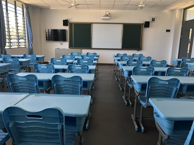 Photo shows classroom utilities including Chinese computers, televisions and projectors. (Photo/People\'s Daily Online)