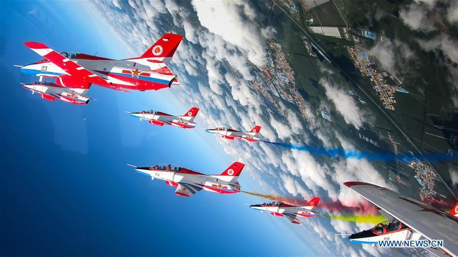 Red Falcon Air Demonstration Team performs during an activity of opening day at the Aviation University of Air Forces in Changchun, capital of northeast China\'s Jilin Province, Aug. 30, 2018. The Chinese Air Force announced a roadmap for building a stronger modern air force in three steps. The building of a stronger modern air force is in line with the overall goal of building national defense and the armed forces, Lieutenant General Xu Anxiang, deputy commander of Chinese Air Force, said at a press conference on celebrating the 69th anniversary of the establishment of Chinese Air Force held in Zhuhai, south China\'s Guangdong Province, Nov. 11, 2018. (Xinhua/Yang Pan)