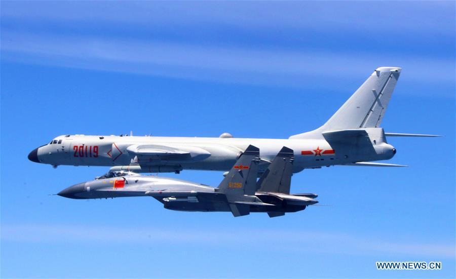 A Chinese People\'s Liberation Army (PLA) air force formation conducts island patrols during training on April 26, 2018. The Chinese Air Force announced a roadmap for building a stronger modern air force in three steps. The building of a stronger modern air force is in line with the overall goal of building national defense and the armed forces, Lieutenant General Xu Anxiang, deputy commander of Chinese Air Force, said at a press conference on celebrating the 69th anniversary of the establishment of Chinese Air Force held in Zhuhai, south China\'s Guangdong Province, Nov. 11, 2018. (Xinhua/Wu Yuepeng)
