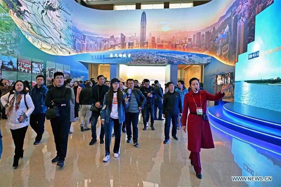 Visitors view exhibits at a major exhibition to commemorate the 40th anniversary of China\'s reform and opening-up held at the National Museum of China in Beijing, capital of China, Nov. 14, 2018. The exhibition opened here on Tuesday. (Xinhua/Li Xin)